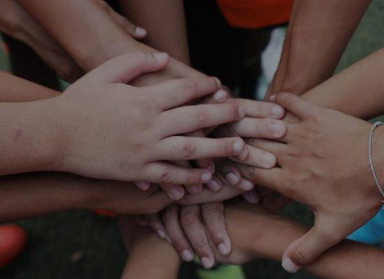 joining hands for teamwork FootballPlus