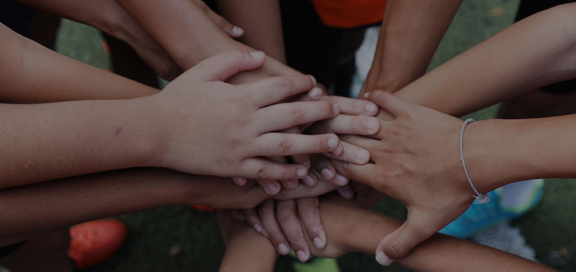 joining hands for teamwork FootballPlus